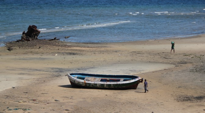 Size Perspective of Boat and Boy; Pemba, Mozambique; 2011