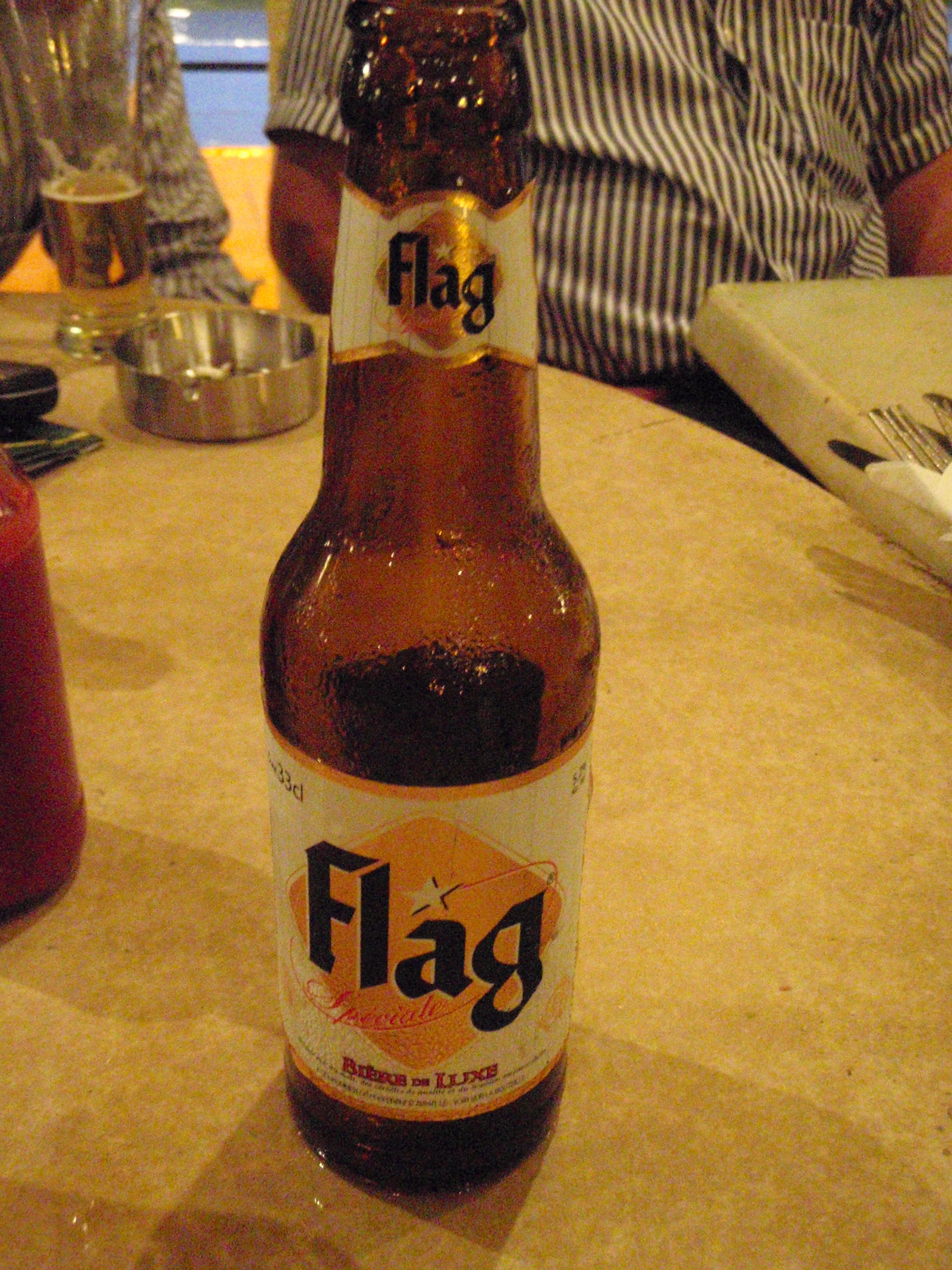 Flag, Local Beer; Conakry, Guinea; 2010